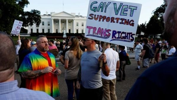 Trans rights activists protest outside the White House in Washington D.C.